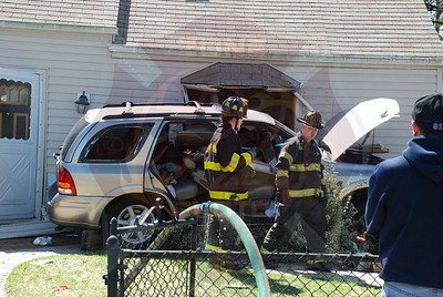 Levittown F.D. MVA w/ Entrapment Car Into House 98 Orchid Ln. 4/5/09
