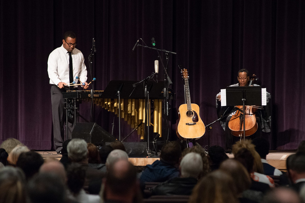 . Josiah Gaiter and his cousin Prudence McDaniel play during a memorial service for Josiah\'s father Lew Gaiter on Saturday morning at Timberline Church in Fort Collins.
