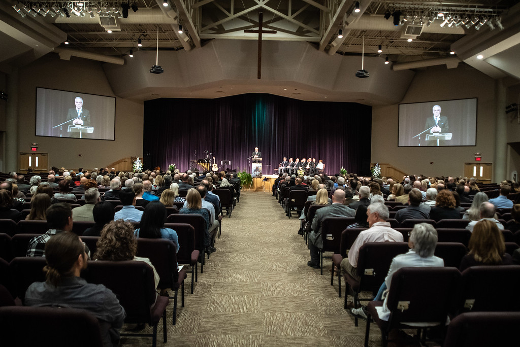 . Pastor Darrell Hailey addresses a crowd during a memorial service for County Commissioner Lew Gaiter on Saturday morning at Timberline Church in Fort Collins. Gaiter who served the community passed away after a battle with cancer.
