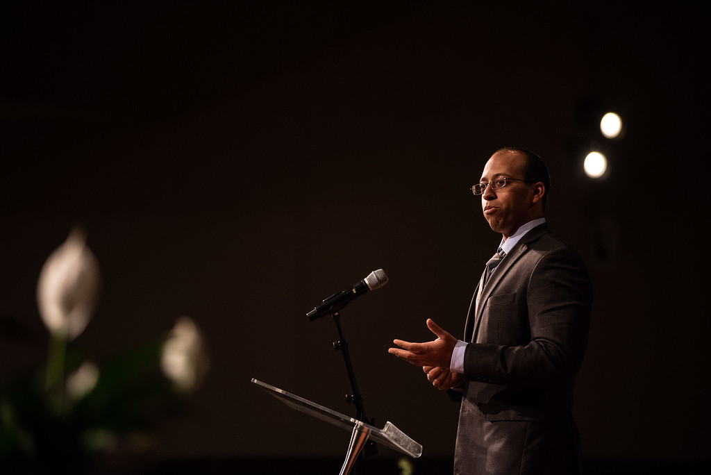 . Micah Gaiter speaks during a memorial service for his father Lew Gaiter on Saturday morning at Timberline Church in Fort Collins.