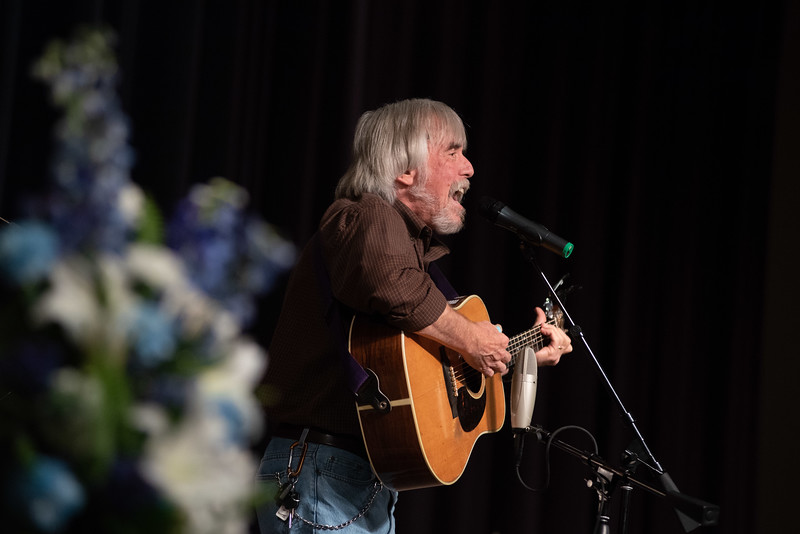 "Musician Don Francisco sings his song ""He's Alive"" during a memorial service for Lew Gaiter on Saturday morning at Timberline Church in Fort Collins."