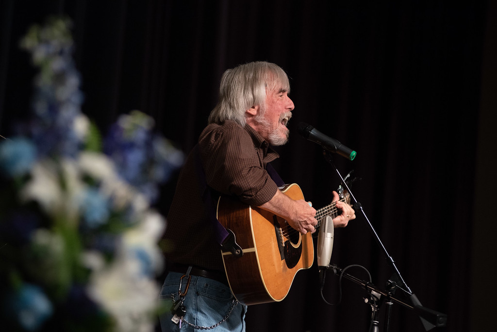 ". Musician Don Francisco sings his song ""He\'s Alive\"" during a memorial service for Lew Gaiter on Saturday morning at Timberline Church in Fort Collins."