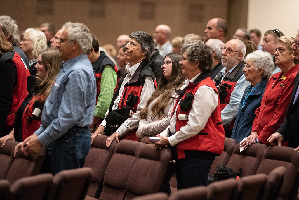 . A crowd, many from the National Ski Patrol and friends of Lew Gaiter stand during a memorial service for the Larimer County Commissioner on Saturday morning at Timberline Church in Fort Collins.