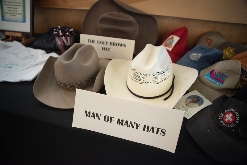 A collection of cowboy hats were part of a collection of momentos displayed during a memorial service for Lew Gaiter on Saturday morning at Timberline Church in Fort Collins.