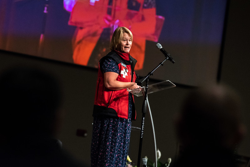 Mary Lorch of the National Ski Patrol speaks to a crowd during a memorial service for her friend and County Commissioner Lew Gaiter on Saturday morning at Timberline Church in Fort Collins. Gaiter who served the community passed away after a battle with cancer.