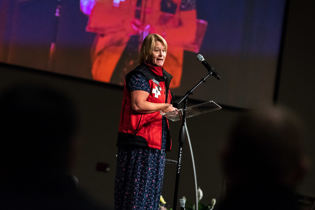 . Mary Lorch of the National Ski Patrol speaks to a crowd during a memorial service for her friend and County Commissioner Lew Gaiter on Saturday morning at Timberline Church in Fort Collins. Gaiter who served the community passed away after a battle with cancer.