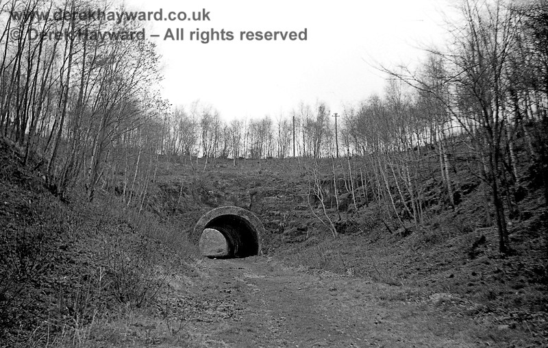 The southern portal of Cinder Hill Tunnel captured on 12 April 1965 in a lovely image taken by John Attfield.  John retains all rights to these images but has kindly allowed me to use them on my site.  In those years the site was far less overgrown.