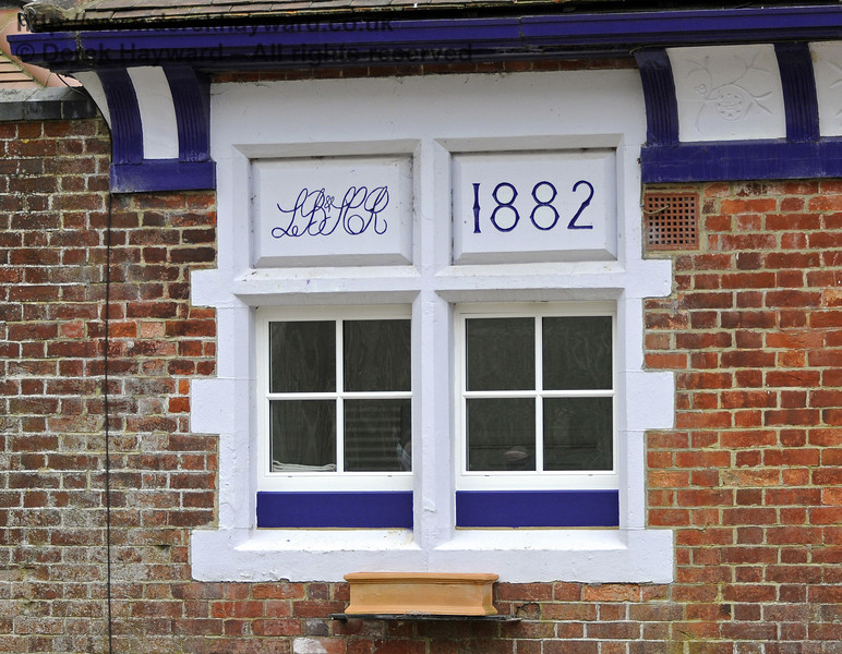 The London, Brighton and South Coast Railway (LB&SCR) left their mark on Barcombe Station in 1882, courtesy of J T Firbank, contractors who built the line.   03.04.2013  8629