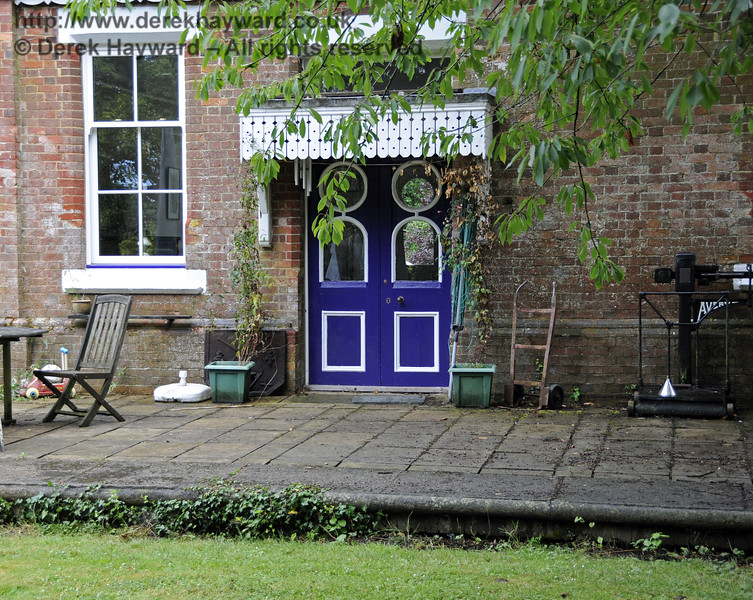 The booking office doors that originally gave access to the station platform at Barcombe Station.  28.07.2014  11343   Please note that this is private property.   Image taken by arrangement with the Bluebell Railway and displayed with the consent of the occupier.