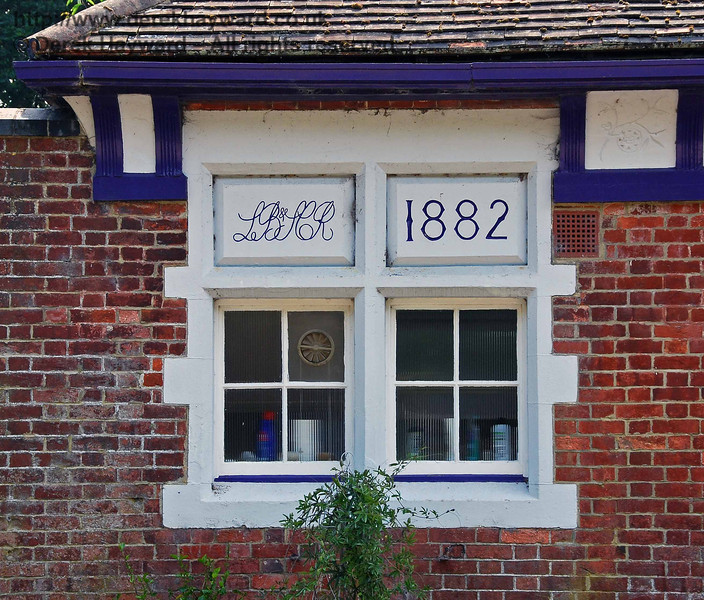 The London, Brighton and South Coast Railway (LB&SCR) left their mark on Barcombe Station in 1882, courtesy of J T Firbank, contractors who built the line.   10.06.2007