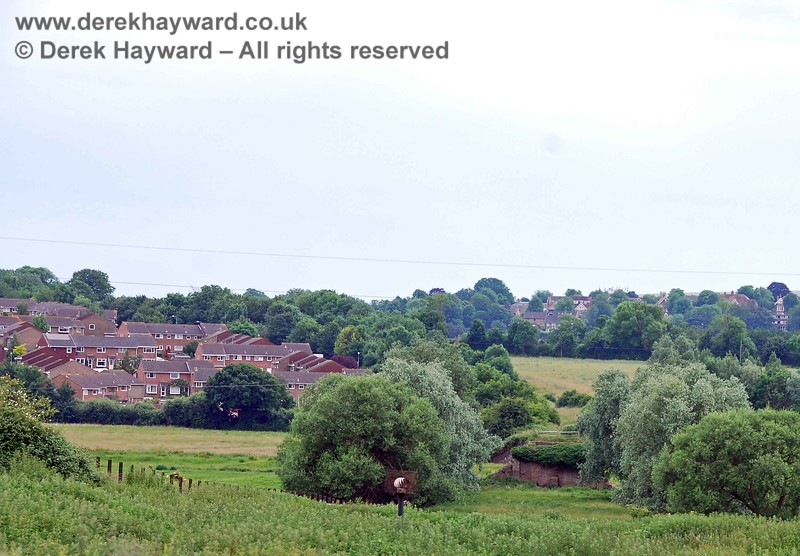 The tour starts at Hamsey Church, south west of Culver Junction.  This view looks south towards the village of South Malling.  The old line from Lewes enters the picture on the middle left, and curves round following the line of trees on the right of the houses.  Nearer the camera you can see the remains of an old bridge where the line crossed the River Ouse.  The slope directly in front of the camera is a cutting which has been totally filled in (shades of the Imberhorne Lane Tip).  Nearest to the camera is a venting system for gases to escape from the fill in the cutting