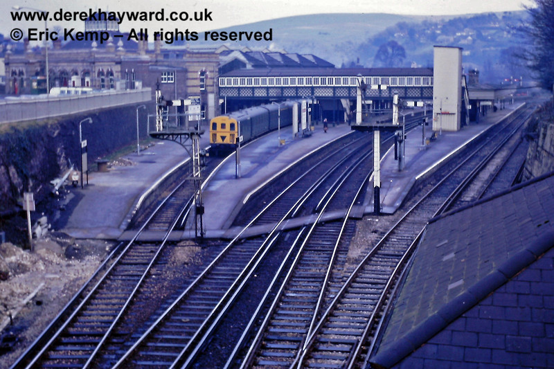 """The Lewes Station gallery is entirely the work of Eric Kemp who retains the copyright and all rights to the images.  I am very grateful to him for supplying these images.  Lewes Station on 01.01.1969.  A 3D unit waits in the double sided platforms 4/5 on an Uckfield line train.  The track was officially the """"Down Brighton Loop"""" but was signalled for bi-directional working.  In practice it was largely used by trains to and from the line through Culver Junction.  The other platforms in shot are Brighton Line Platforms 6 - 8 (out of a total of 8).  On the extreme right is the roof of """"D"""" signal box and the """"Up Loop Siding"""" which terminated in buffer stops by the box."""