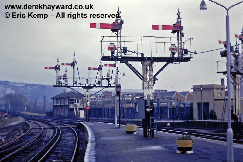 """A magnificent array of signals at the eastern end of the platforms at Lewes on 01.01.1969.  Lewes 'B' or Main Junction Signal Box is in the background.  On the extreme left is the """"Down Siding"""" serving the two goods docks.  As trains left the station they would turn left towards Culver Junction (the points are just out of shot) or right towards Hastings."""