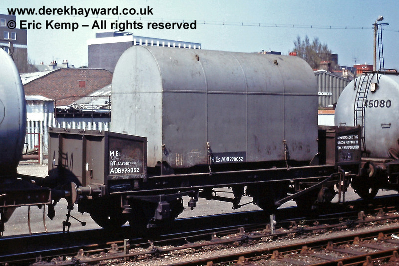 """This is actually Eastbourne on 10.05.1980, but the image allows a closer look at the engine transporter wagon in the previous picture.  The legends are  MEs, 13T, tare 10 100kg.  The number is ADB998052, with a wheel base of 15' 0.  At the end away from the camera staff are instructed """"WHEN LOADED THIS WAGON MUST NOT BE FLY OR HUMP SHUNTED"""" (a sensible stipulation for a DEMU engine, although """"humps"""" were not frequently found on the Southern Region....).   I am advised that the wagon was one of four specially built for the purpose."""