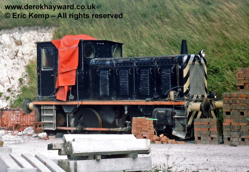 """The Southerham Cement Works, outside Lewes, had it's own diesel shunter, seen here out of use on 21.07.1985.  The locomotive was subsequently preserved on the Spa Valley Railway, and has since been named """"Southerham""""."""