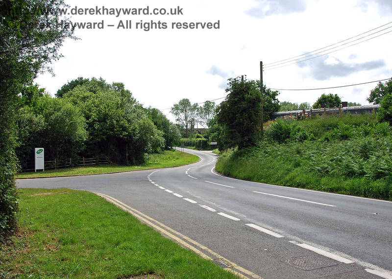 A second view of the same area, this time looking south.  The embankment is just to the right of the sign.