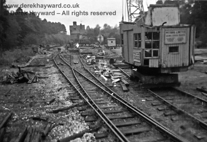 Newick and Chailey Station in the process of being demolished, in an undated image kindly supplied by Brenda Barnes.  The photograph probably dates from around 1959/1960, and a crane belonging to the demolition contractor Pittrail is on the right.  Brenda Barnes retains all rights to the image, which has received some restoration.
