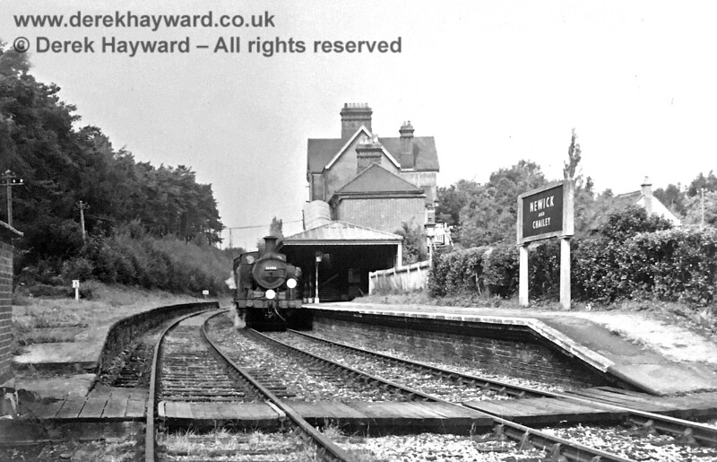Brenda Barnes has kindly supplied this undated image of Newick and Chailey Station when it was still open.  The number of the southbound engine is not quite clear enough to read but some detective work by Martin Shaw has established that it was 32484.  Brenda Barnes retains all rights to the image, which has received some restoration.