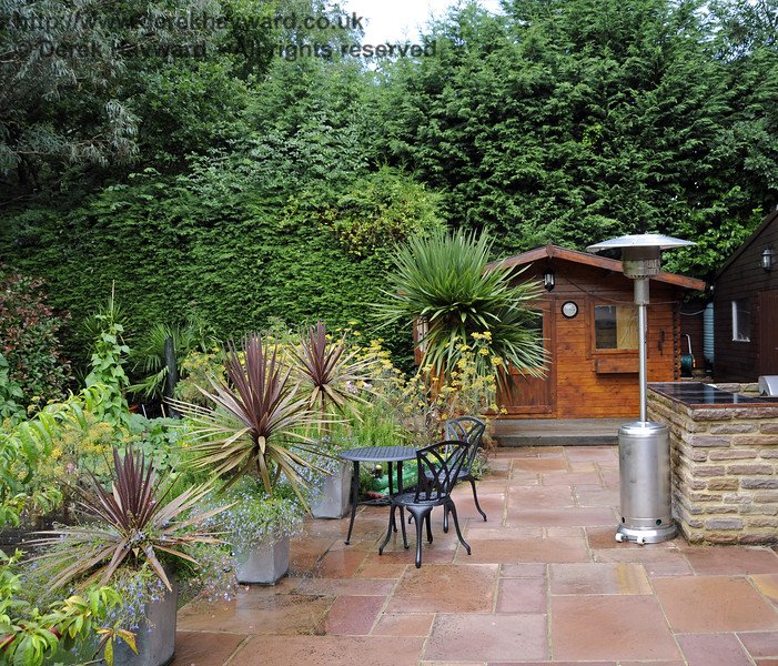 The private back garden of a property in Newick & Chailey.  This is a patio, but it is what lies underneath that is interesting.  28.07.2014 11329