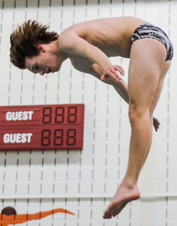 Lewisburg's Erik Temple flips during diving practice at Susquehana University on Thursday.