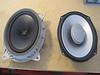 Comparison:<br /> Left: OEM speaker (front view)<br /> Right: Aftermarket speaker (front view)