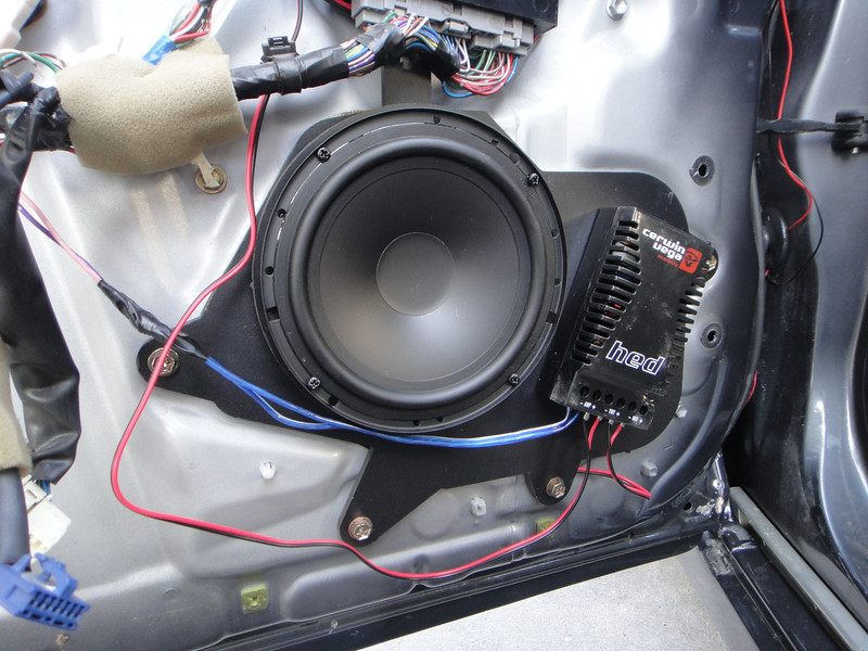 "Speaker adapter bracket from  <a href=""http://www.car-speaker-adapters.com/items.php?id=SAK002""> Car-Speaker-Adapters.com</a>   , aftermarket speaker and crossover installed"