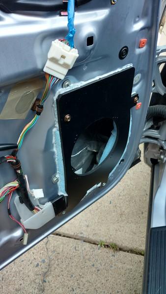 "Speaker adapter from <a href=""http://car-speaker-adapters.com/items.php?id=SAK087""> Car-Speaker-Adapters.com</a>  installed on door.  Sealant installed."