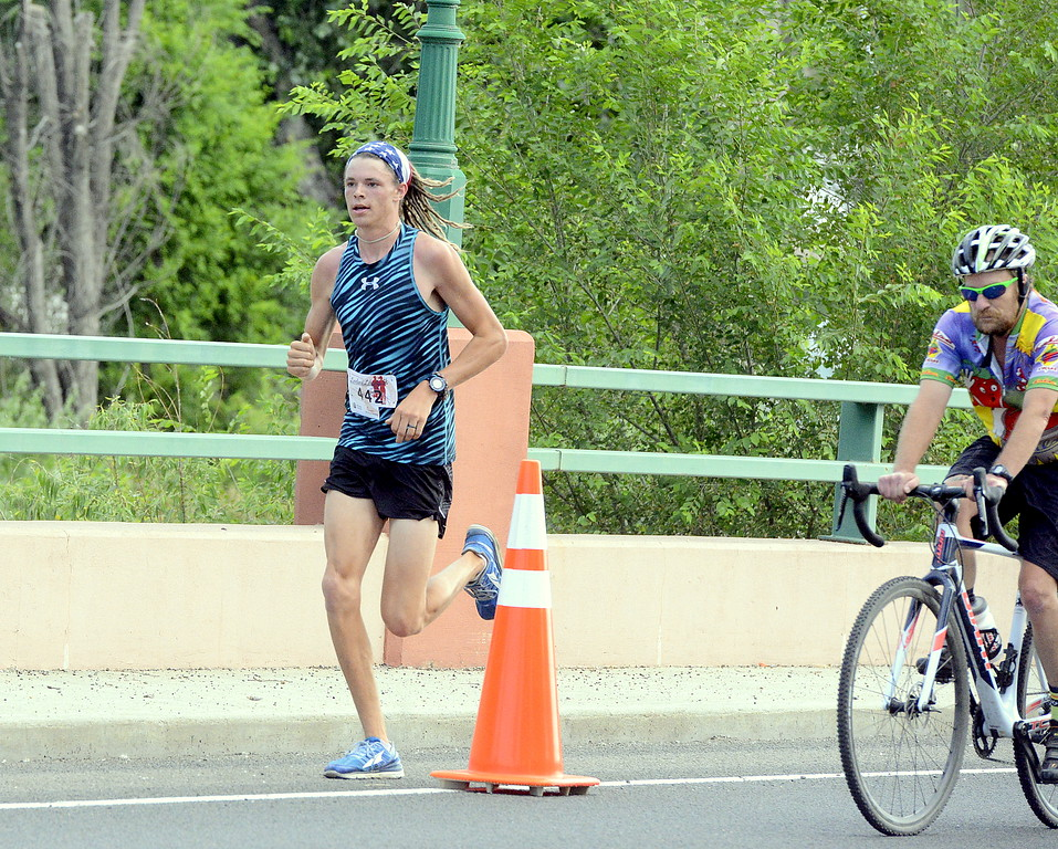 . Mason Phillips took ran away from the field in winning his third men\'s title at Wednesday\'s Liberty 5K at Fairgrounds Park. Phillips finished in a time of 17:21. (Mike Brohard/Loveland Reporter-Herald)