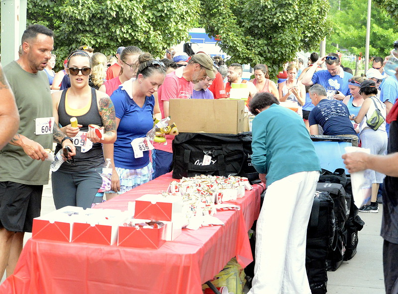 Popcorn, sandwiches, fruit and water were waiting for the finishers at the end of Wednesday's Liberty 5K at Fairgrounds Park. (Mike Brohard/Loveland Reporter-Herald)