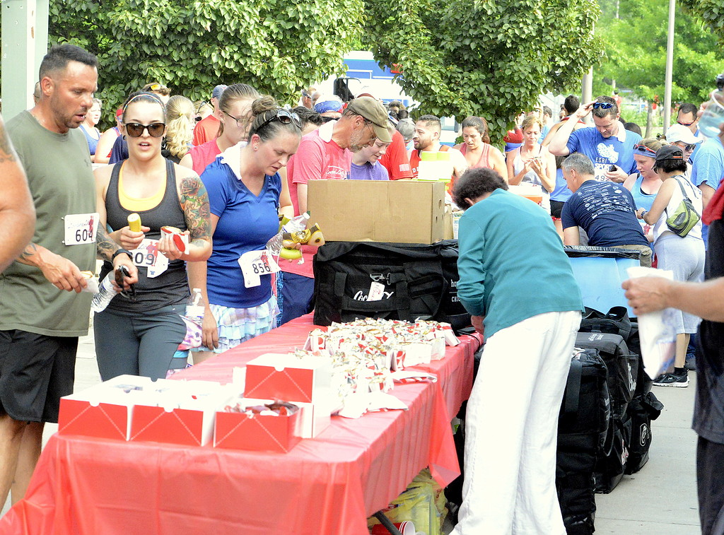 . Popcorn, sandwiches, fruit and water were waiting for the finishers at the end of Wednesday\'s Liberty 5K at Fairgrounds Park. (Mike Brohard/Loveland Reporter-Herald)