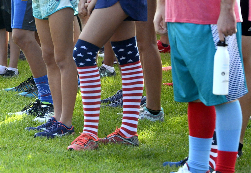 Cadence Lapp sported the pulled her flag socks up high for Wednesday's Liberty 5K at Fairgrounds Park. (Mike Brohard/Loveland Reporter-Herald)