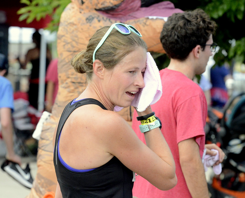 . Women\'s winner Ruth Waller-Liddle wipes her face with a cool towel after Wednesday\'s Liberty 5K at Fairgrounds Park. (Mike Brohard/Loveland Reporter-Herald)