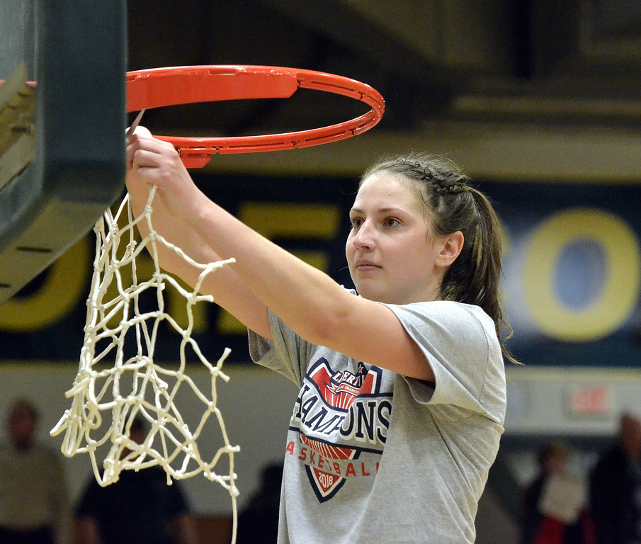 . STAAN HUDY - SHUDY@DIGITALFIRSTMEDIA.COMAverill Park grad Kelly Donnelly cuts down a piece of the net after the Liberty League women\'s basketball tournament final Sunday Feb. 25, 2018.