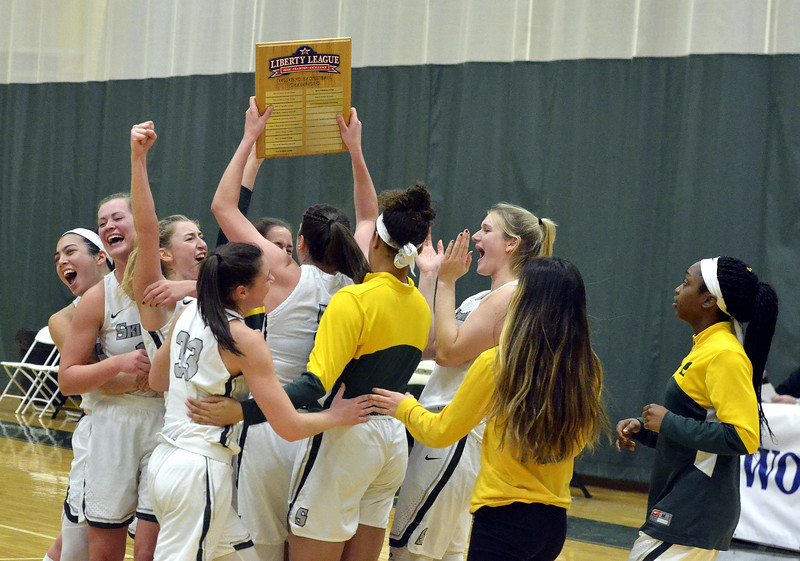STAN HUIDY - SHUDY@DIGITALFIRSTMEDIA.COM<br /> The Skidmore College women's basketball team hold up the Liberty League tournament championship plaque Sunday afternoon at the Williamson Center on the Skidmore College Campus. Feb. 25, 2018.