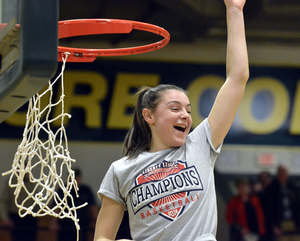 . STAN HUIDY - SHUDY@DIGITALFIRSTMEDIA.COMSkidmore College senior Veronica Moceri looks back off the ladder to her teammates during the net-cutting ceremony Sunday afternoon at the Williamson Center on the Skidmore College Campus after winning the Liberty League title game. Feb. 25, 2018.