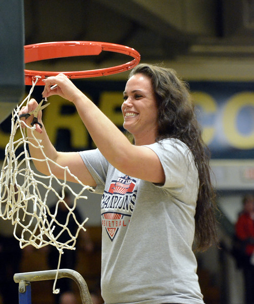 STAAN HUDY - SHUDY@DIGITALFIRSTMEDIA.COM<br /> Skidmore College assistant coach Elise Schlump cuts down part of the net after the Liberty League women's basketball tournament final Sunday Feb. 25, 2018.