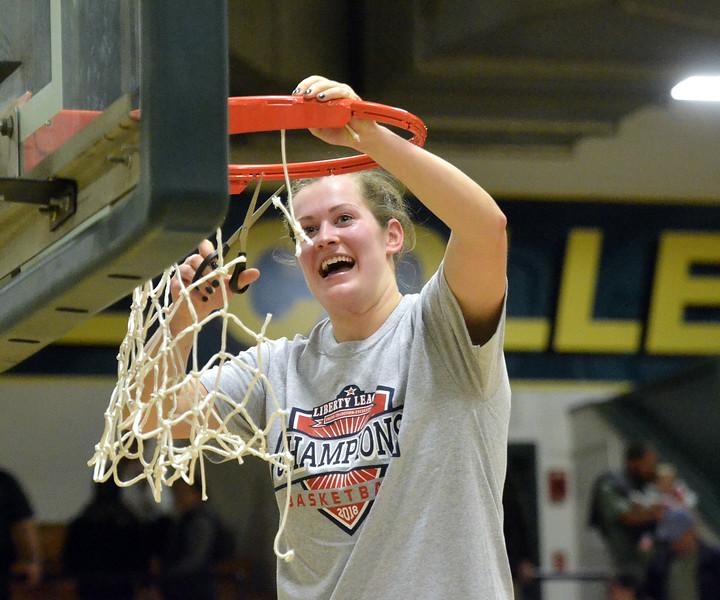 STAAN HUDY - SHUDY@DIGITALFIRSTMEDIA.COM<br /> Caite Opfer cuts down part of the net after the Liberty League women's basketball tournament final Sunday Feb. 25, 2018.
