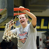STAAN HUDY - SHUDY@DIGITALFIRSTMEDIA.COM<br /> Caite Opfer cuts down part of the net after the Liberty League women's basketball tournament final Sunday Feb. 25, 2018.