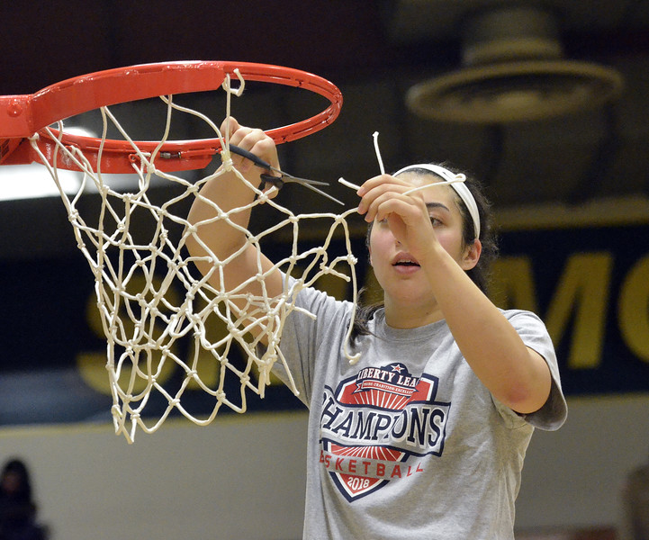 STAAN HUDY - SHUDY@DIGITALFIRSTMEDIA.COM<br /> Taylor Ong cuts down a piece of the net at the end of the Liberty League women's basketball tournament final Sunday Feb. 25, 2018.