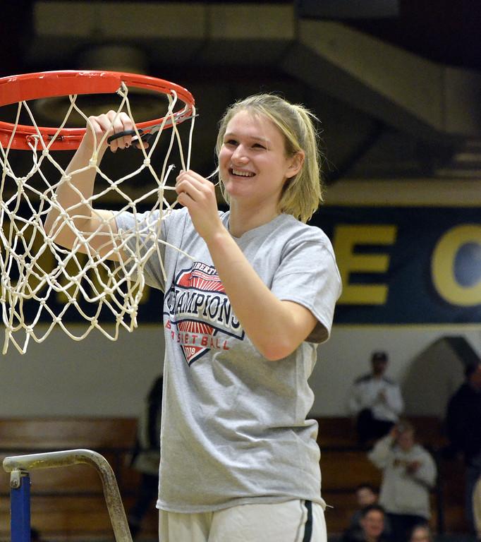 . STAAN HUDY - SHUDY@DIGITALFIRSTMEDIA.COMLilly Berg cuts down a piece of the net after the Liberty League women\'s basketball tournament final Sunday Feb. 25, 2018.