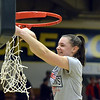 STAAN HUDY - SHUDY@DIGITALFIRSTMEDIA.COM<br /> Veronica Moceri cuts down a piece of the net after the Liberty League women's basketball tournament final Sunday Feb. 25, 2018.