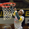 STAAN HUDY - SHUDY@DIGITALFIRSTMEDIA.COM<br /> Kayla Mitchell cuts down part of the net after the Liberty League women's basketball tournament final Sunday Feb. 25, 2018.