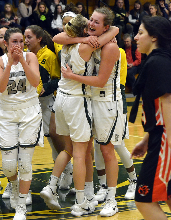 . STAN HUIDY - SHUDY@DIGITALFIRSTMEDIA.COMSkidmore College seniors Ari Fustini (4) hugs Catie Opfer with junior Haley English (24) nearby Sunday afternoon at the Williamson Center on the Skidmore College Campus after winning the 2018 Liberty League title. Feb. 25, 2018.
