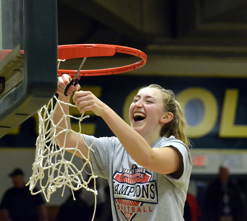 . STAAN HUDY - SHUDY@DIGITALFIRSTMEDIA.COMAri Fustini is all smiles as she cuts down part of the net after the Liberty League women\'s basketball tournament final Sunday Feb. 25, 2018.