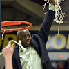 STAN HUIDY - SHUDY@DIGITALFIRSTMEDIA.COM<br /> Skidmore College women's basketball coach Darren Bennett holds up the cut down net after his Thorougbreds won the LIberty League tournament title game Sunday afternoon at the Williamson Center on the Skidmore College Campu. Feb. 25, 2018.
