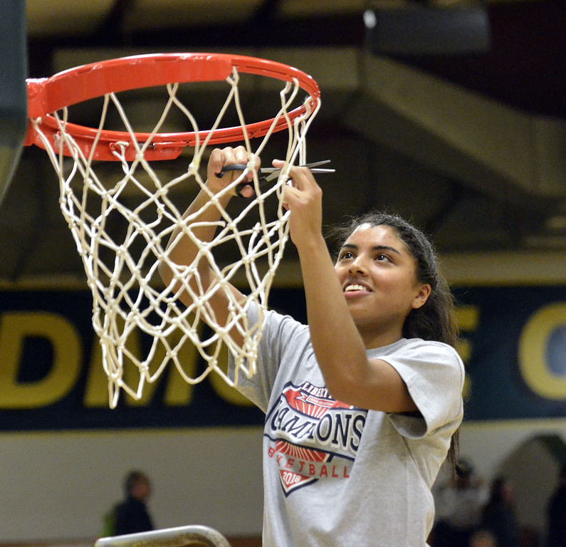 . STAAN HUDY - SHUDY@DIGITALFIRSTMEDIA.COMJessica Centore cuts down a piece of the net at the end of the Liberty League women\'s basketball tournament final Sunday Feb. 25, 2018.