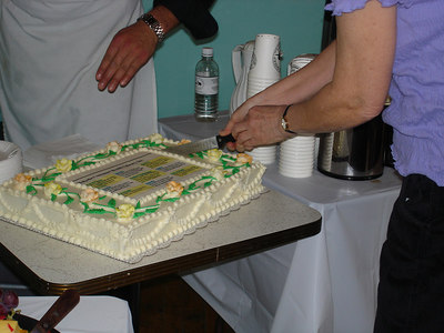 and cuts the cake.  Delicious carrot cake!