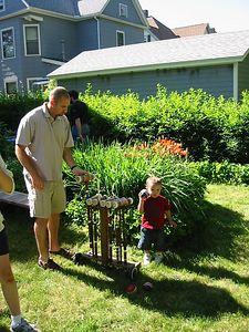 Daniel and son play croquet