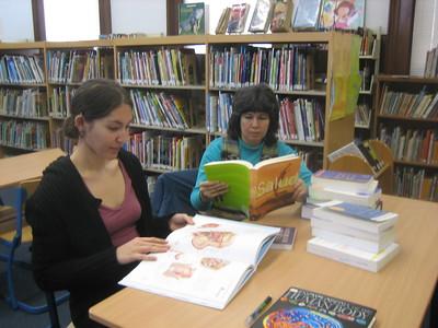 Kathleen Packard and Maria Pagan examine new books.