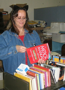 Terry processing a new book donated by HCHL. October 31, 2005 (Halloween)